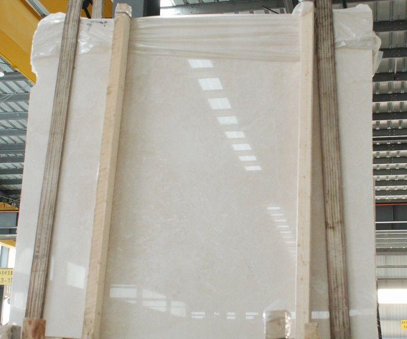 联系热线甄先生18911186738 18910801945 QQ1640314471 中文名:白玉兰 底 色:白色系 推荐使用:室内地面室内墙面 白玉兰--天然大理石板材为高饰面材料,石材白玉兰米黄大理石:规格:20(mm),比重:合格(g/cm3),抗压强度:合格(MPa),抗弯强度:合格(MPa),适用范围:墙面地面,产地:伊朗,光泽度:100,品牌:A级,颜色:黄色,硬度:高,杂质:无。本产品光洁高,无色差,花纹匀称是室内装修墙面地面最佳产品.